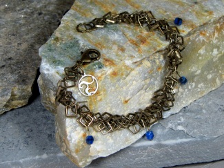 Bracelet - Vision, square droplet brass chain draped with blue Czech glass.