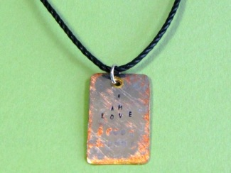 Necklace - I am love, personalized hand stamped dog tag on waxed black cotton cord.