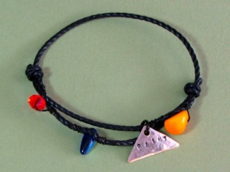 Bracelet - Paint, waxed black cotton cord, Picasso Jasper, Swarovski crystal, glass and hand stamped tag.